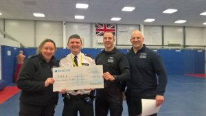 Patrol Base Officer Safety Instructors Present Cheque to JACK